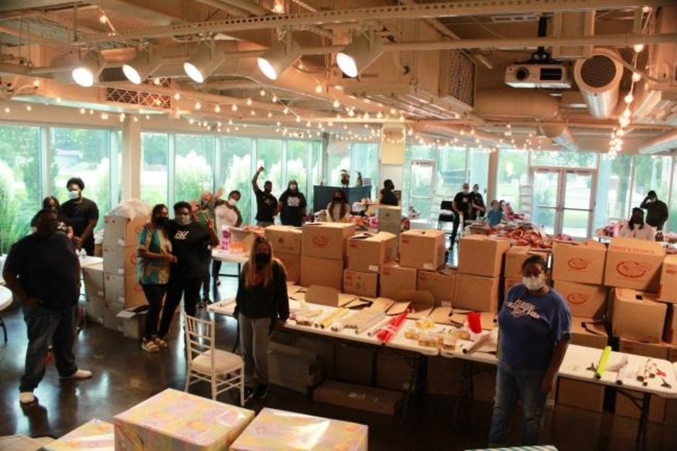 Photo -  Freedom Worship volunteers gather to wrap gifts distributed during the church's Christmas in September gift distribution in northeast Oklahoma City. [Photo provided]