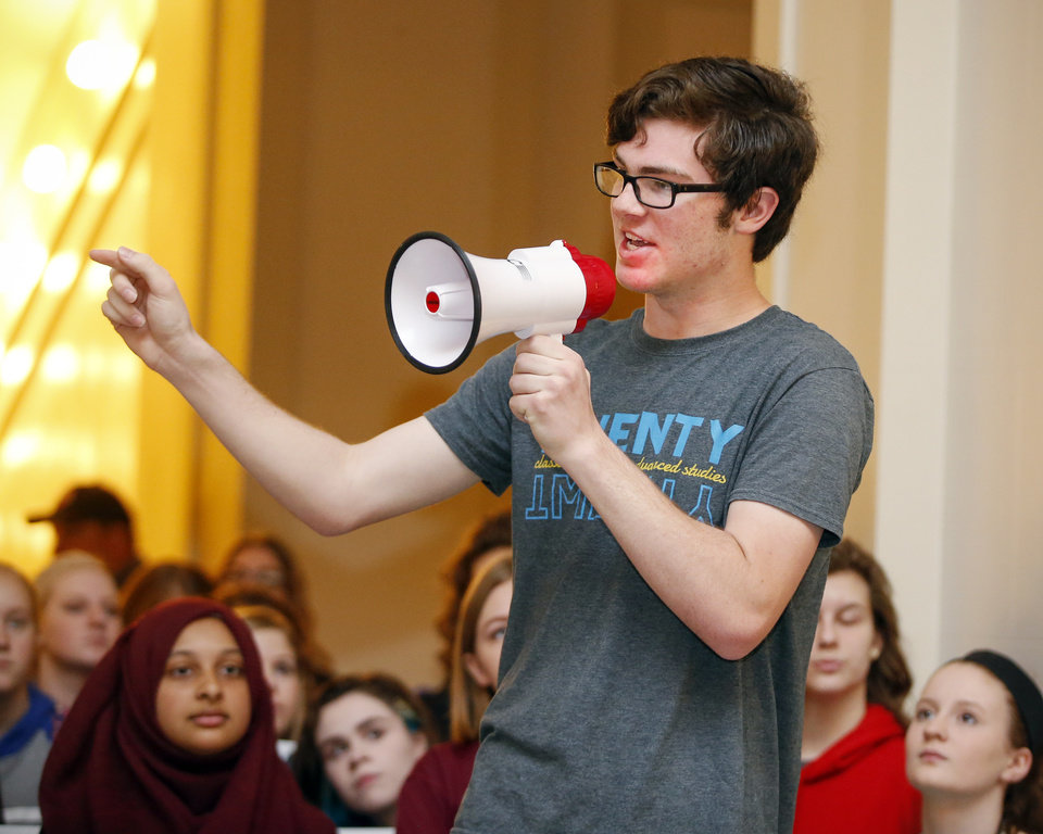 Photo - Cameron Olbert, a Classen School of Advanced Studies sophomore, speaks at a rally led by students on the second floor of the state Capitol during the eighth day of a walkout by Oklahoma teachers, in Oklahoma City, Monday, April 9, 2018. Photo by Nate Billings, The Oklahoman