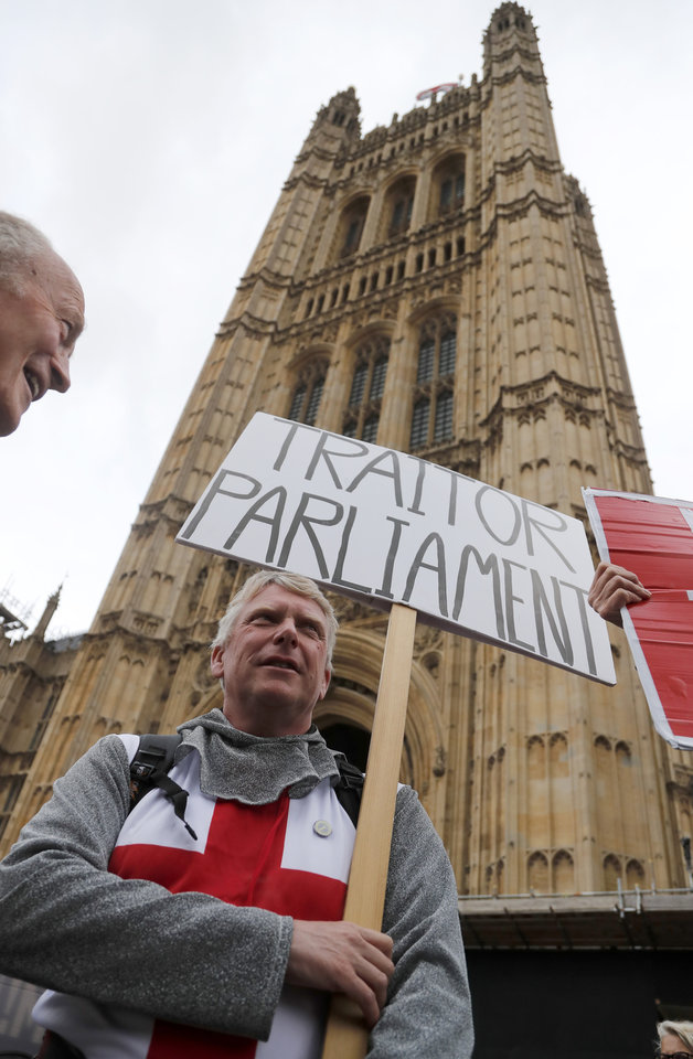 Photo -  A protestor shows a poster opposite parliament in London, Monday, Sept. 9, 2019. British Prime Minister Boris Johnson voiced optimism Monday that a new Brexit deal can be reached so Britain leaves the European Union by Oct. 31.(AP Photo/Frank Augstein)