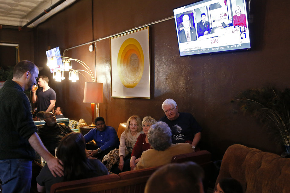 Photo - Democratic Party supporters gathered Tuesday night at Rockford Cocktail Den in Oklahoma City to await election results in the 2016 presidential contest pitting Hillary Clinton against GOP candidate Donald Trump. Oklahomans on Tuesday also cast votes on several state ballot measures, a host of legislative contests and other local issues and offices. Photo by Sarah Phipps, The Oklahoman
