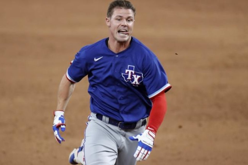 Photo -  Texas Rangers' Scott Heineman sprints to third with a triple during an intrasquad game July 9 in Arlington, Texas. [AP Photo/Tony Gutierrez]