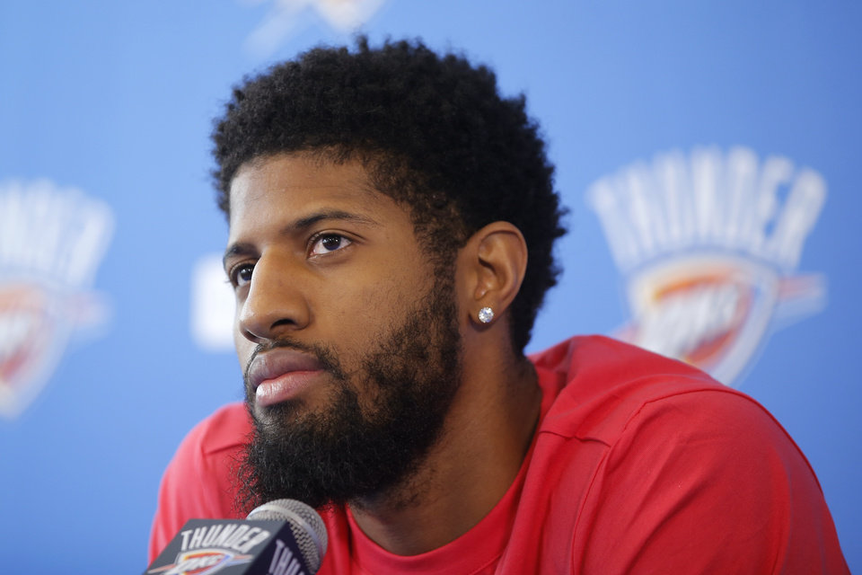 Photo - Oklahoma City's Paul George speaks to the media during exit interviews for the Oklahoma City Thunder at the Integris Thunder Development Center in Oklahoma City, Okla., Saturday, April 28, 2018. Photo by Bryan Terry, The Oklahoman