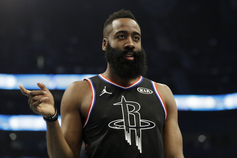 Photo - Team LeBron's James Harden, of the Houston Rockets, moves on the court against Team Giannis during the first half of an NBA All-Star basketball game, Sunday, Feb. 17, 2019, in Charlotte, N.C. (AP Photo/Chuck Burton)