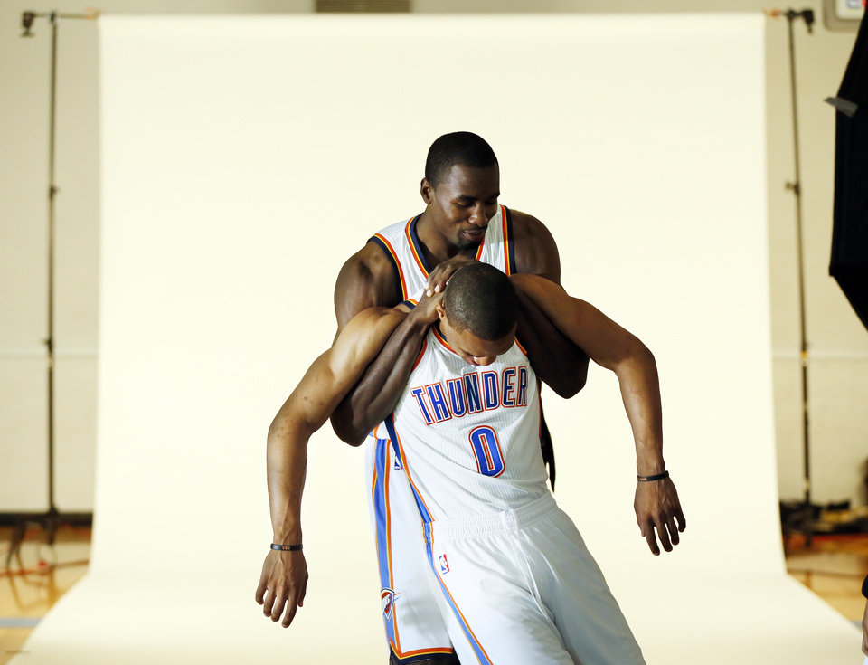 Photo - Serge Ibaka, back, jokes around with Russell Westbrook during media day for the Oklahoma City Thunder NBA basketball team at the Thunder Events Center in Oklahoma City, Monday, Oct. 1, 2012.  Photo by Nate Billings, The Oklahoman