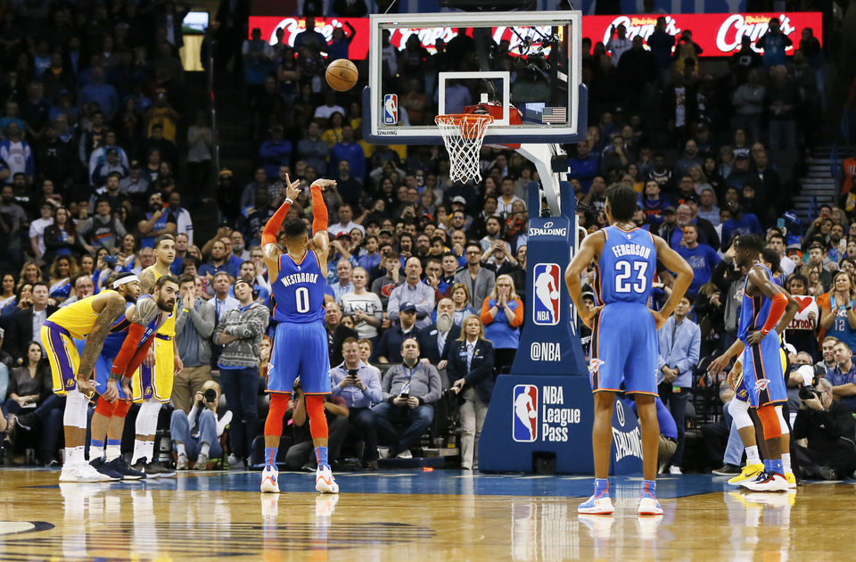 Photo - Oklahoma City's Russell Westbrook (0) shoots one of the three free throws he made to tie the game in the fourth quarter before overtime during an NBA basketball game between the Los Angeles Lakers and the Oklahoma City Thunder at Chesapeake Energy Arena in Oklahoma City, Thursday, Jan. 17, 2019. Los Angeles won 128-138 in overtime. Photo by Nate Billings, The Oklahoman