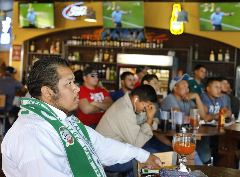 Photo -  Disappointed fans of Mexico watch their team lose to Sweden in a World Cup match on Wednesday. Their grief turned to elation when South Korea beat Germany, ensuring Mexico would advance. [Photo by Jim Beckel, The Oklahoman]