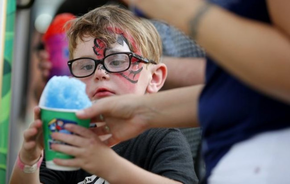 Photo -  Kane Tomlinson, 5, gets a shaved ice drink during Red Brick Nights. [BRYAN TERRY/THE OKLAHOMAN]