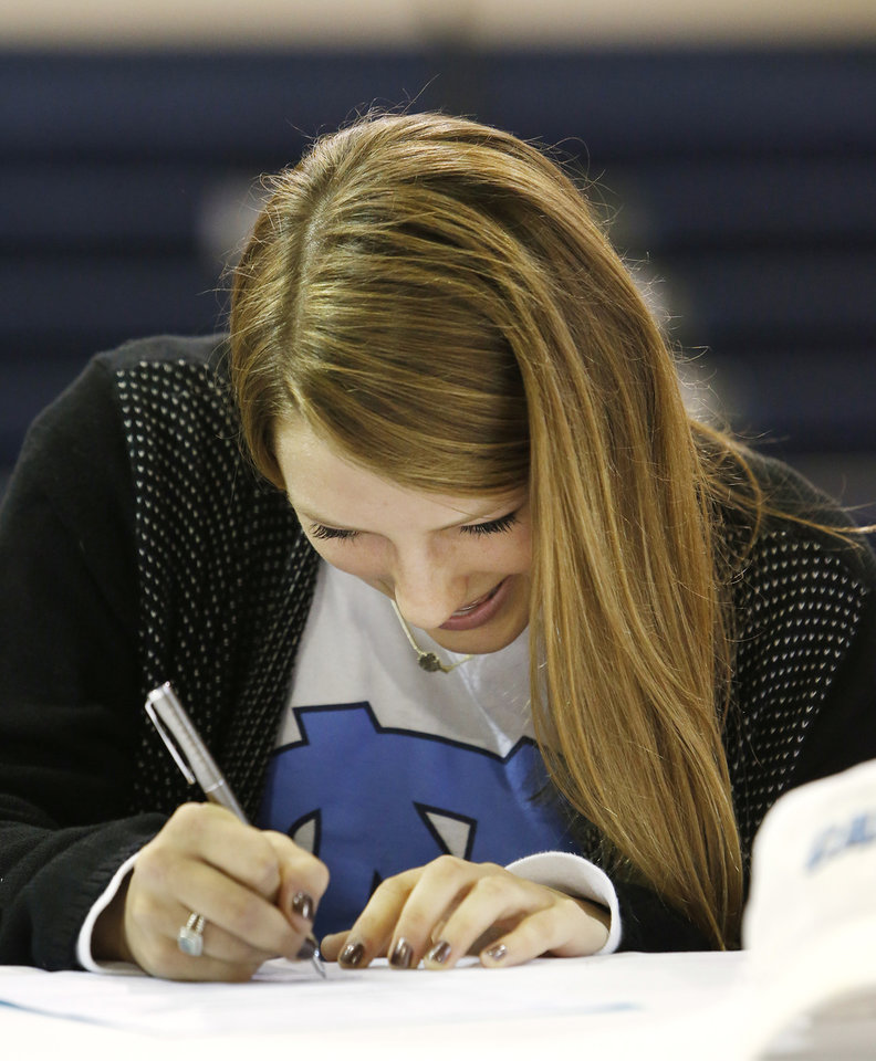 Photo - Casady High School field hockey athlete Ellen Payne signing her letter of intent during signing day ceremonies at Casady High School in Oklahoma City Wednesday, Feb. 4, 2015. Photo by Paul B. Southerland, The Oklahoman
