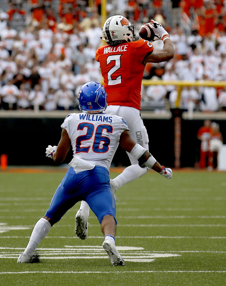 Photo - Oklahoma State's Tylan Wallace (2) makes a catch in front of Boise State's Avery Williams (26) in the fourth quarter during a college football game between the Oklahoma State Cowboys (OSU) and the Boise State Broncos at Boone Pickens Stadium in Stillwater, Okla., Saturday, Sept. 15, 2018. OSU won 44-21. Photo by Sarah Phipps, The Oklahoman