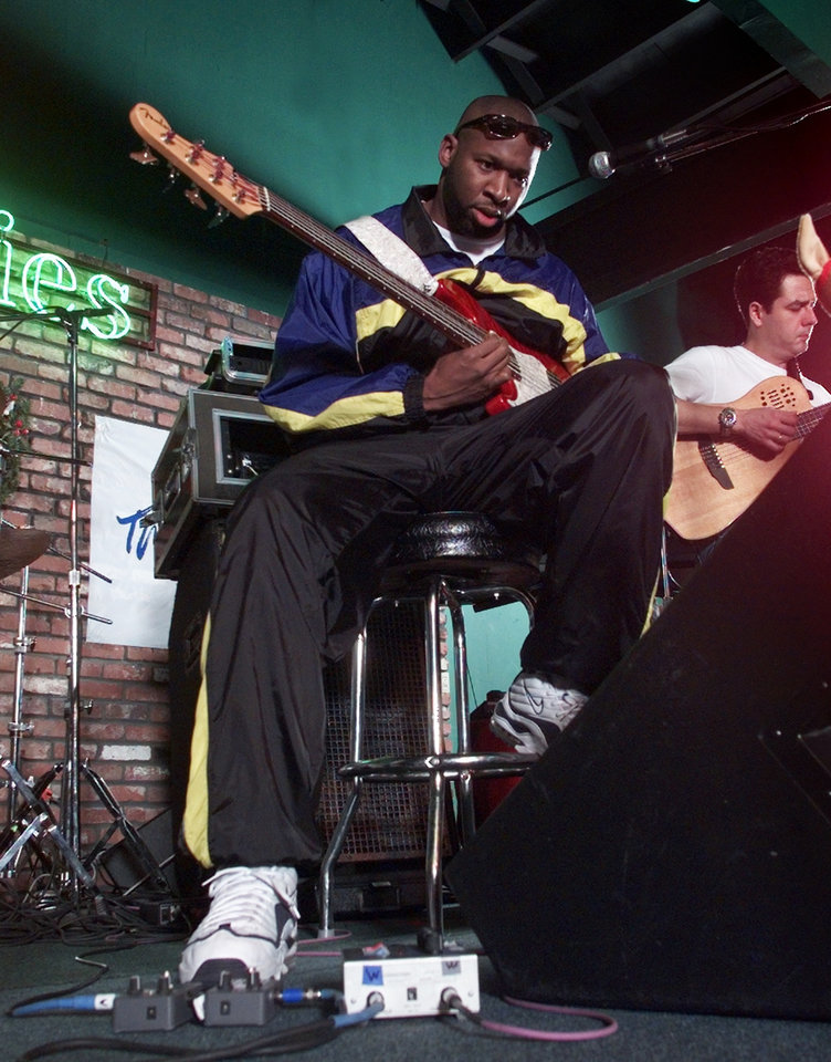 Photo - Former OU basketball star Wayman Tisdale goes through a sound check with his band at Bricktown Birdies.