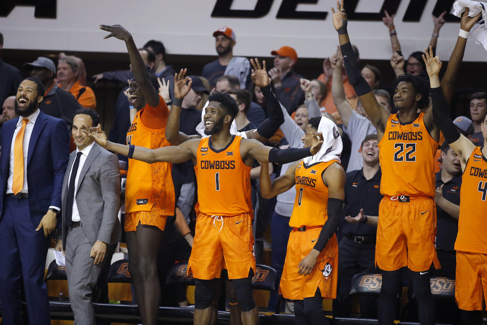 Photo - Oklahoma State's Yor Anei (14), Jonathan Laurent (1), Avery Anderson III (0) and Kalib Boone (22) celebrate during an NCAA men's Bedlam basketball game between the Oklahoma State University Cowboys (OSU) and the University of Oklahoma Sooners (OU) at Gallagher-Iba Arena in Stillwater, Okla., Saturday, Feb. 22, 2020. Oklahoma State won 83-66. [Bryan Terry/The Oklahoman]