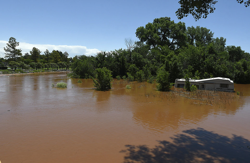 Photo - Uncle John Creek is overflowing it's banks in Kingfisher, Okla., Tuesday May 21, 2019. (Billy Hefton/Enid News & Eagle via AP)