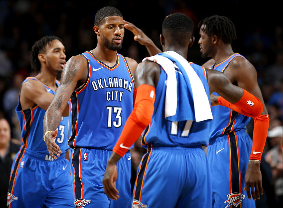 Photo - Oklahoma City's Paul George (13) celebrates with teammates during the NBA game between the Oklahoma City Thunder and the Utah Jazz at the Chesapeake Energy Arena, Friday, Feb. 22, 2019. Photo by Sarah Phipps, The Oklahoman