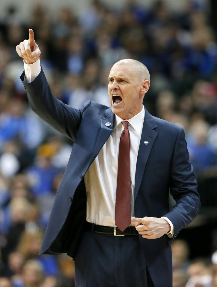 Photo - Dallas Mavericks head coach Rick Carlisle instructs his team on offense in the second half of an NBA basketball game against the Oklahoma City Thunder on Wednesday, Feb. 24, 2016, in Dallas. The Thunder won 116-103. (AP Photo/Tony Gutierrez)