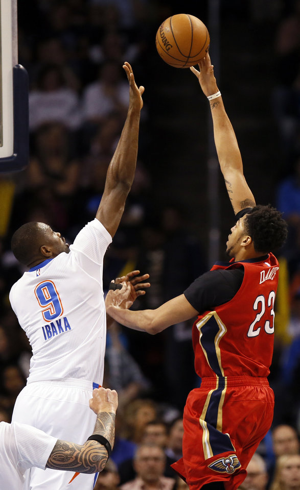 Photo - New Orleans' Anthony Davis (23) shoots against Oklahoma City's Serge Ibaka (9) during an NBA basketball game between the New Orleans Pelicans and the Oklahoma City Thunder at Chesapeake Energy Arena in Oklahoma City, Thursday, Feb. 11, 2016.  Photo by Nate Billings, The Oklahoman