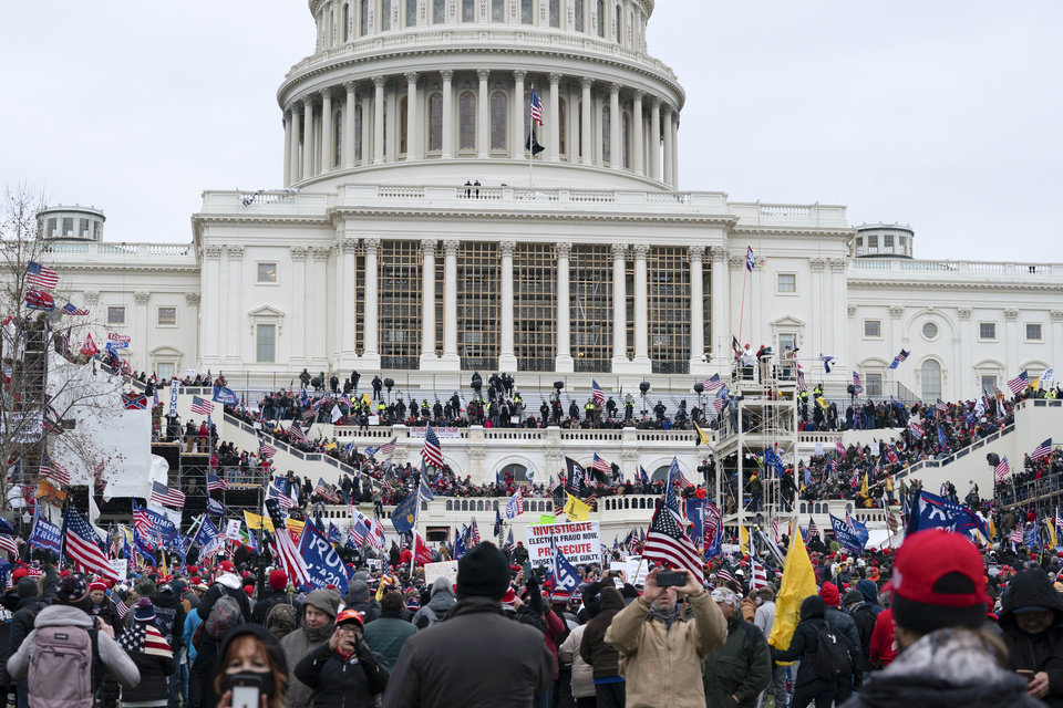 Photo - Trump supporters gather outside the Capitol, Wednesday, Jan. 6, 2021, in Washington. As Congress prepares to affirm President-elect Joe Biden's victory, thousands of people have gathered to show their support for President Donald Trump and his claims of election fraud. (AP Photo/Jose Luis Magana)