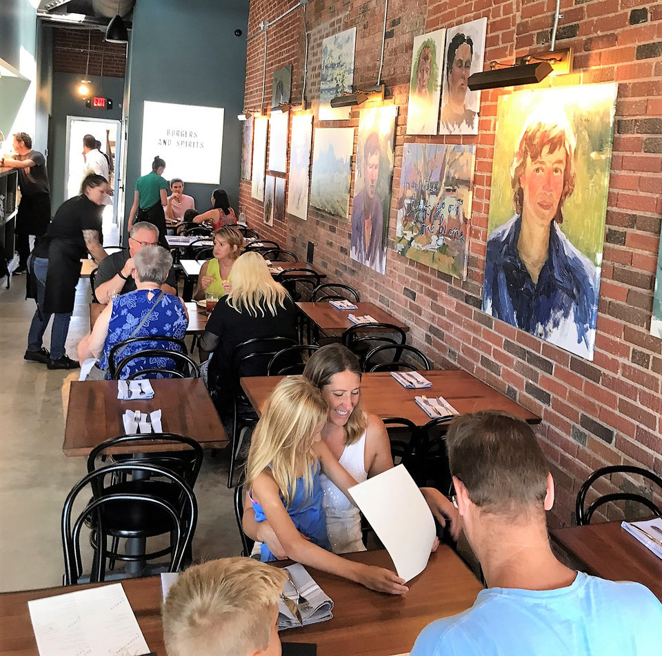 Photo - Diners trickled into New State Burgers for a soft opening Saturday. The restaurant should open this week in Oklahoma City's Plaza District. [Dave Cathey/The Oklahoman]