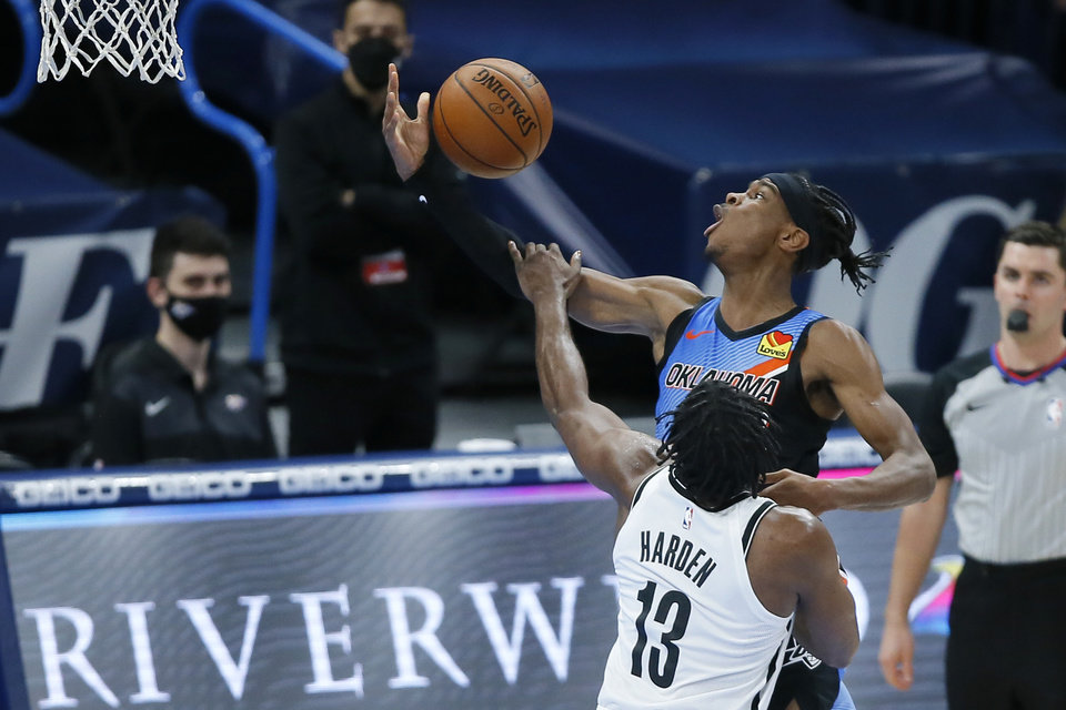 Photo - Oklahoma City's Shai Gilgeous-Alexander (2) is fouled by Brooklyn's James Harden (13) during an NBA basketball game between the Oklahoma City Thunder and the Brooklyn Nets at Chesapeake Energy Arena in Oklahoma City, Friday, Jan. 29, 2021. [Bryan Terry/The Oklahoman]