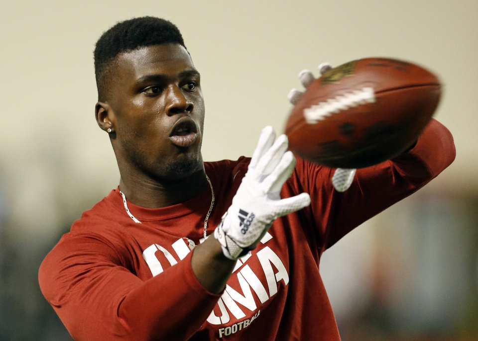 Photo - Dorial Green-Beckham catches passes as players participate in Pro Day at the University of Oklahoma (OU) on March 11, 2015 in Norman, Okla.  Photo by Steve Sisney, The Oklahoman
