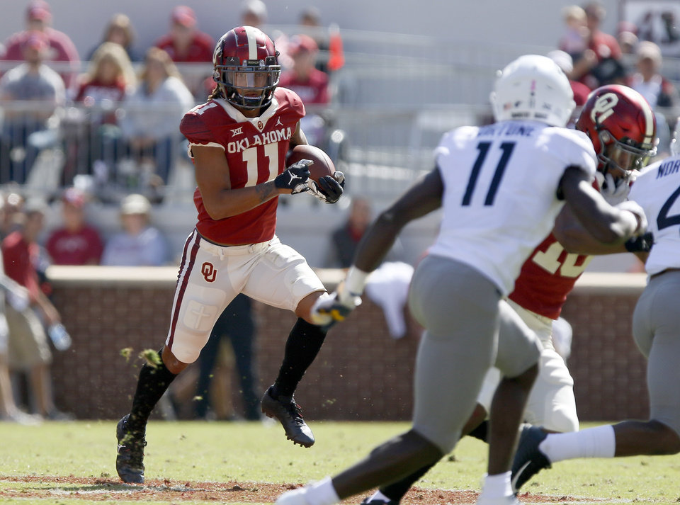 Photo - Oklahoma's Jadon Haselwood (11) runs after a reception during a college football game between the University of Oklahoma Sooners (OU) and the West Virginia Mountaineers at Gaylord Family-Oklahoma Memorial Stadium in Norman, Okla, Saturday, Oct. 19, 2019. Oklahoma won 52-14. [Bryan Terry/The Oklahoman]