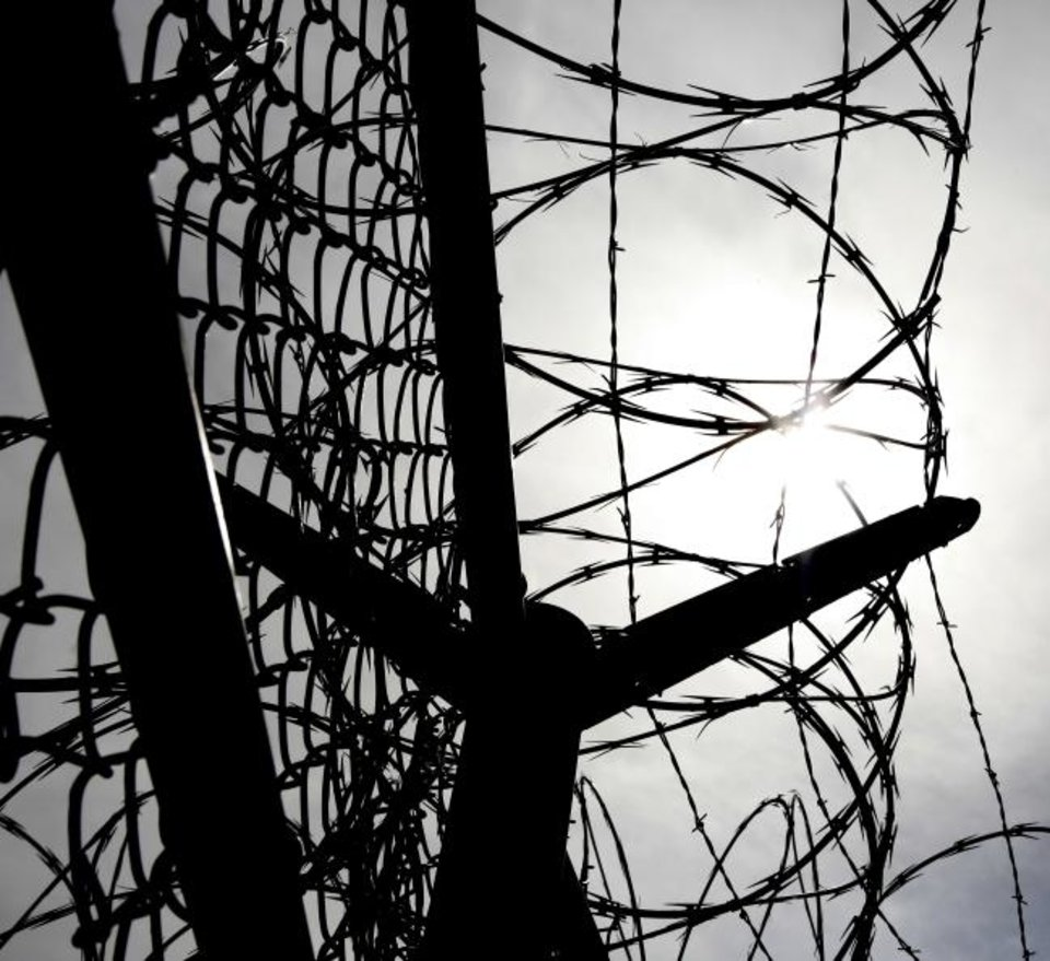 Photo -  Razor wire was on many of the fences at the North Fork Correctional Center in Sayre, Okla., Thursday, June 23, 2016. Photo by Kurt Steiss, The Oklahoman