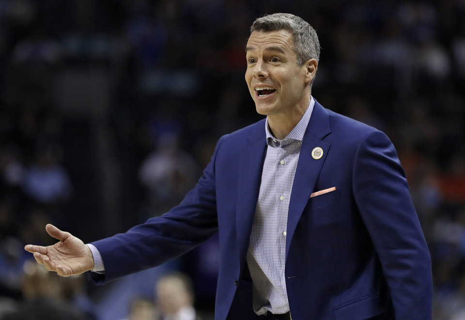 Photo - Virginia head coach Tony Bennett reacts to a call during the second half of an NCAA college basketball game against Florida State in the Atlantic Coast Conference tournament in Charlotte, N.C., Friday, March 15, 2019. (AP Photo/Nell Redmond)