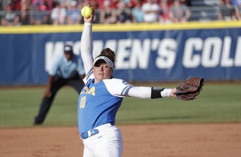 Photo - UCLA's Rachel Garcia pitches against Oklahoma in the first inning of the first game of the best-of-three championship series in the NCAA softball Women's College World Series in Oklahoma City, Monday, June 3, 2019. (AP Photo/Alonzo Adams)
