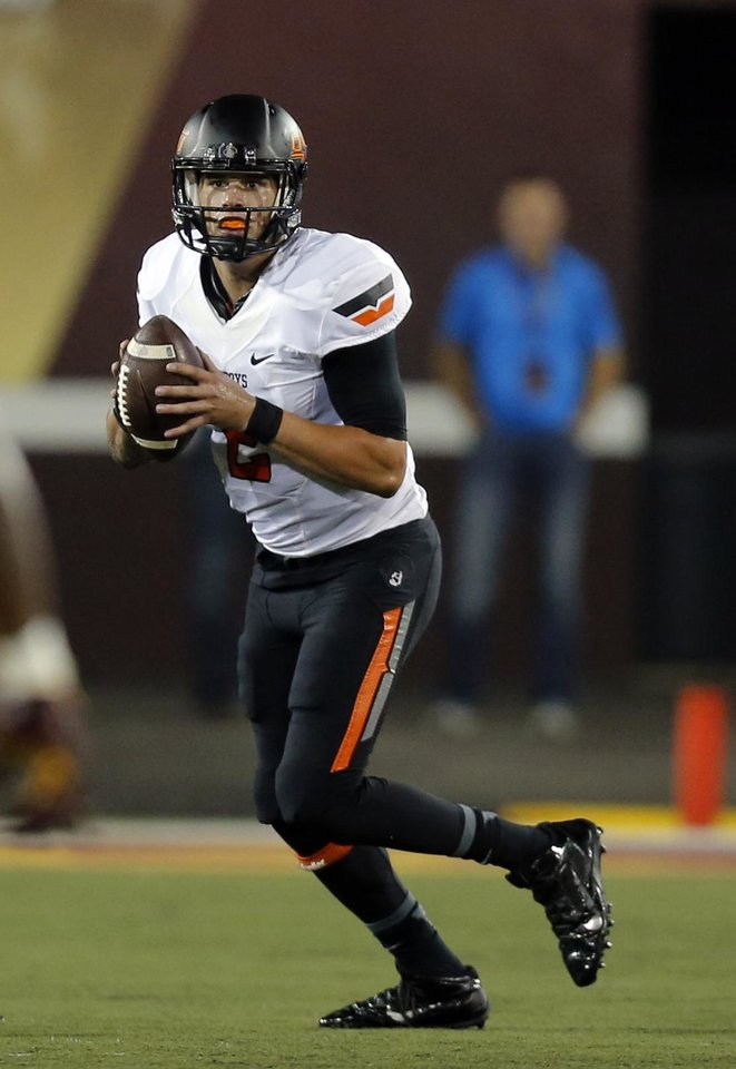 Photo - Oklahoma State's Mason Rudolph (2) looks to throw the ball during the college football game between the Central Michigan Chippewas and the Oklahoma State University Cowboys at the Kelly-Shorts Stadium in Mount Pleasant, Mich., Thursday, Sept. 3, 2015. Photo by Sarah Phipps, The Oklahoman
