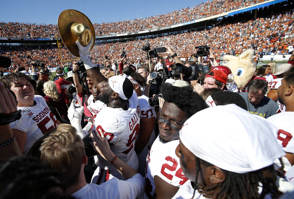 Photo - Oklahoma's Neville Gallimore (90) celebrates following the Red River Showdown college football game between the University of Oklahoma Sooners (OU) and the Texas Longhorns (UT) at Cotton Bowl Stadium in Dallas, Saturday, Oct. 12, 2019. OU won 34-27. [Sarah Phipps/The Oklahoman]