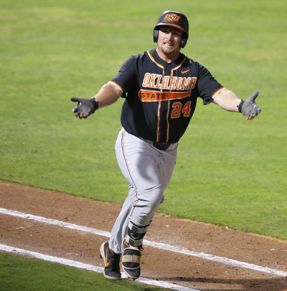 Photo - Oklahoma State's Colin Simpson celebrates after hitting a home run in the eighth inning of a bedlam baseball game between Oklahoma State University (OSU) and the University of Oklahoma (OU) at Chickasaw Bricktown Ballpark in Oklahoma City, Saturday, May 11, 2019. [Bryan Terry/The Oklahoman]