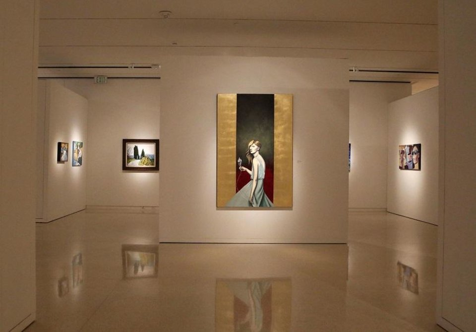 "Photo - Artwork by 22 Oklahoma artists is displayed in the exhibit ""Between the Isms: The Oklahoma Society of Impressionists and Selected Oklahoma Expressionists"" at the Fred Jones Jr. Museum of Art in Norman Oklahoma on July 11, 2019. The exhibit is on view through Sept. 8. [Paxson Haws/The Oklahoman]"