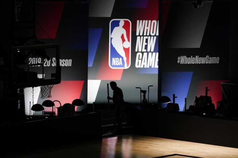 Photo -  The NBA will turn on the lights for its season restart Thursday in Florida after the regular season was halted March 11 due to the coronavirus pandemic. [AP Photo/Ashley Landis]