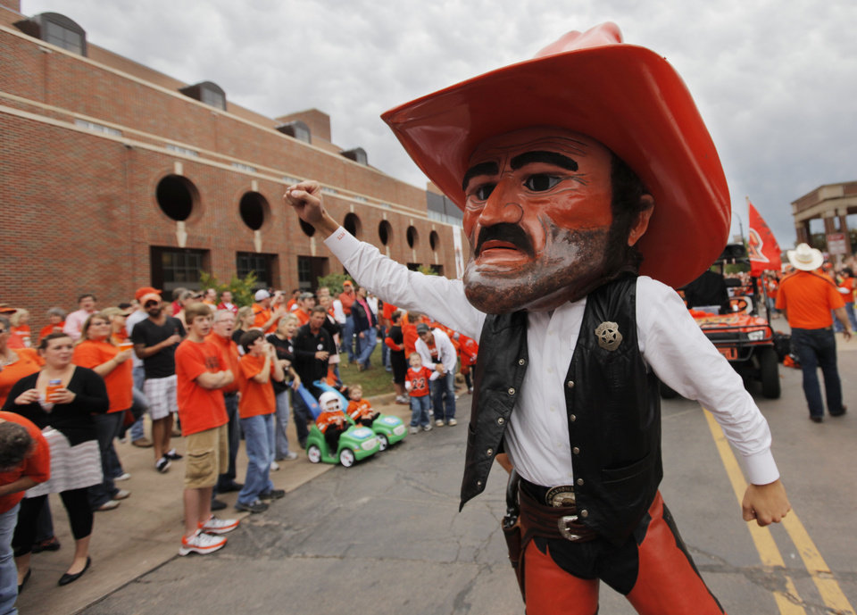 Photo - OSU mascot Pistol Pete gets fans ready for the Spirit Walk before the college football game between the Oklahoma State Cowboys (OSU) and the Nebraska Huskers (NU) at Boone Pickens Stadium in Stillwater, Okla., Saturday, Oct. 23, 2010. Photo by Nate Billings, The Oklahoman
