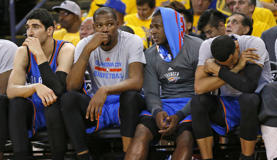 Photo - From left, Oklahoma City's Enes Kanter (11), Kevin Durant (35), Dion Waiters (3) and Andre Roberson (21) sit on the bench in the fourth quarter during Game 2 of the Western Conference finals in the NBA playoffs between the Oklahoma City Thunder and the Golden State Warriors at Oracle Arena in Oakland, Calif., Wednesday, May 18, 2016. Golden State won 118-91. Photo by Nate Billings, The Oklahoman
