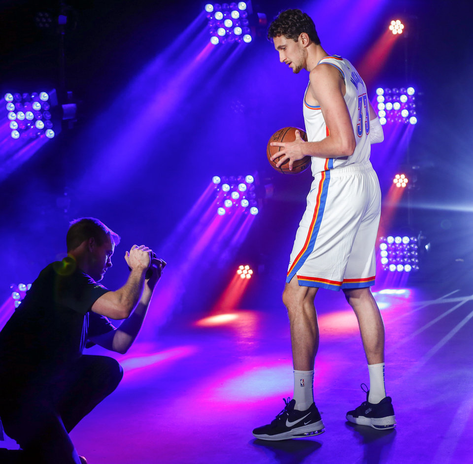 Photo - Oklahoma City's Mike Muscala poses during a photo shoot at media day for the Oklahoma City Thunder NBA basketball team at Chesapeake Energy Arena in Oklahoma City, Monday, Sept. 30, 2019. [Nate Billings/The Oklahoman]