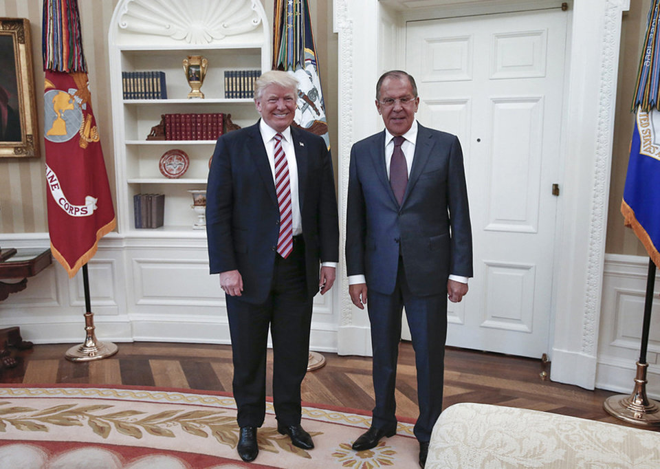 Photo - President Donald Trump meets with Russian Russian Foreign Minister Sergey Lavrov, right, in the White House in Washington, Wednesday, May 10, 2017. President Donald Trump on Wednesday welcomed Vladimir Putin's top diplomat to the White House for Trump's highest level face-to-face contact with a Russian government official since he took office in January. (Russian Foreign Ministry Photo via AP)