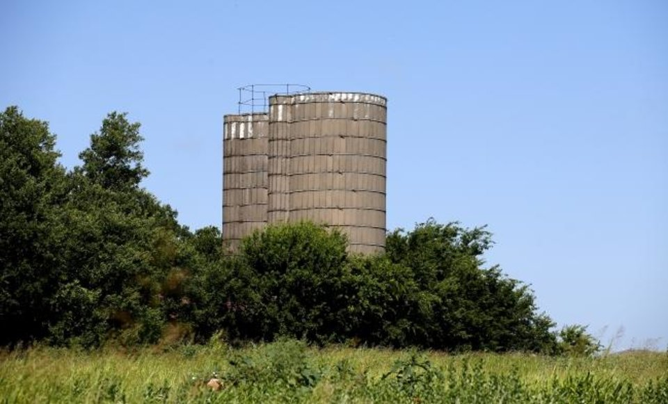 Photo -  A new housing addition is being developed on land that was once the farm of Lee Genzer, whose survivors remember fondly the twin silos in northwest Oklahoma City. [Sarah Phipps photos/The Oklahoman]
