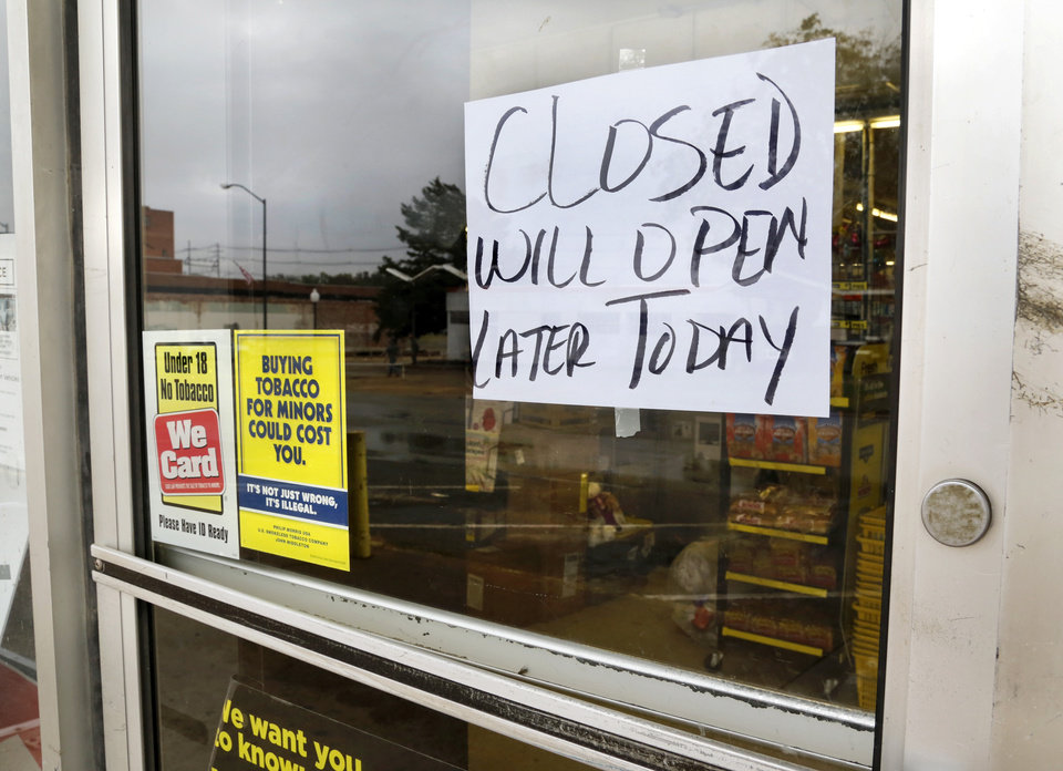 Photo - Hand-written note taped to front door of Dollar General store in downtown Cushing. Damage in Cushing on Monday, Nov. 7, 2016, caused by Sunday night's 5.0 magnitude earthquake. Photo by Jim Beckel, The Oklahoman