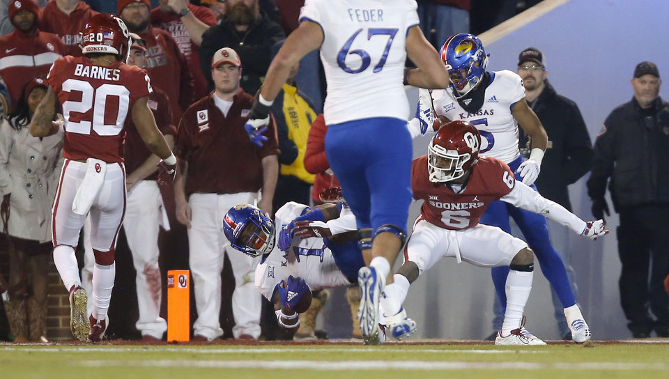 Photo - Pooka Williams Jr. (1) scores a touchdown past Oklahoma's Tre Brown (6) during a college football game between the University of Oklahoma Sooners (OU) and the Kansas Jayhawks (KU) at Gaylord Family-Oklahoma Memorial Stadium in Norman, Okla., Saturday, Nov. 17, 2018. Photo by Bryan Terry, The Oklahoman