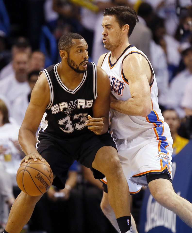 Photo - San Antonio's Boris Diaw (33) works against Oklahoma City's Nick Collison (4) during Game 4 of the Western Conference semifinals between the Oklahoma City Thunder and the San Antonio Spurs in the NBA playoffs at Chesapeake Energy Arena in Oklahoma City, Sunday, May 8, 2016. Photo by Nate Billings, The Oklahoman