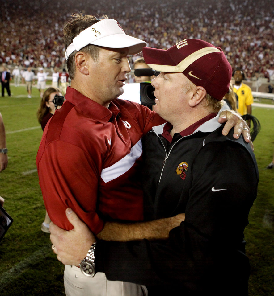 Photo - Oklahoma coach Bob Stoops and his brother Mark Stoops, Florida State defensive coordinator, talk after a college football game between the University of Oklahoma (OU) and Florida State (FSU) at Doak Campbell Stadium in Tallahassee, Fla., Saturday, Sept. 17, 2011. Oklahoma won 23-13. Photo by Bryan Terry, The Oklahoman ORG XMIT: KOD