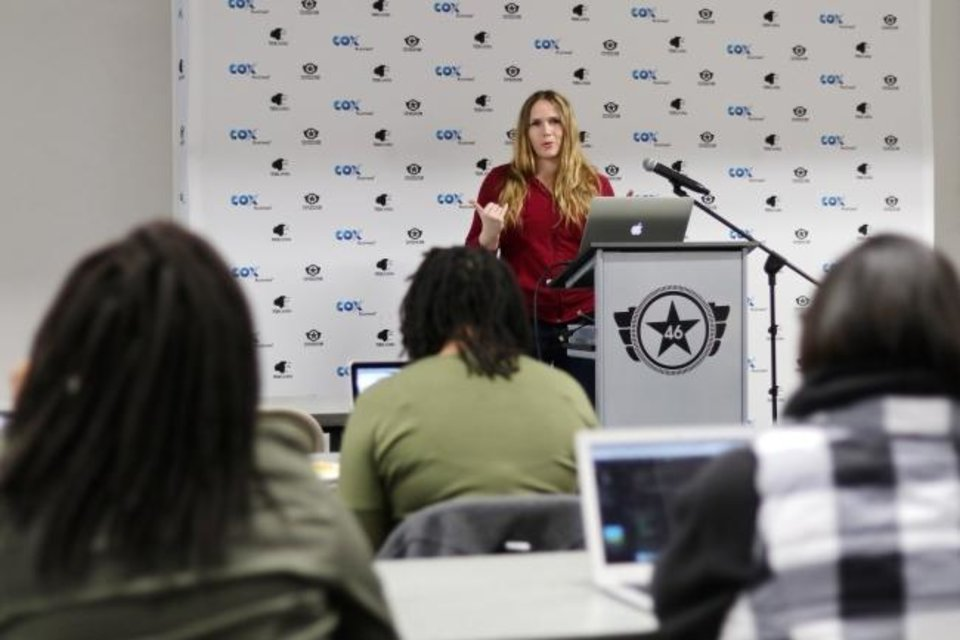 Photo -  Sabrina Gelbart talks about the latest in Java code in January. SheCodes, a group of female technologists come together each month to learn and support each other.   [Doug Hoke/The Oklahoman]