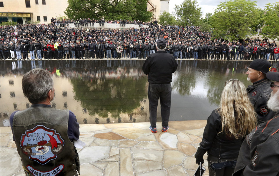 Photo -  Mike Turpen, center, back to camera, thanks riders for their participation in the fundraising event during the brief ceremony around the Reflecting Pool. Turpen is chairman for the Oklahoma City National Memorial Foundation. [Photo by Jim Beckel, The Oklahoman]