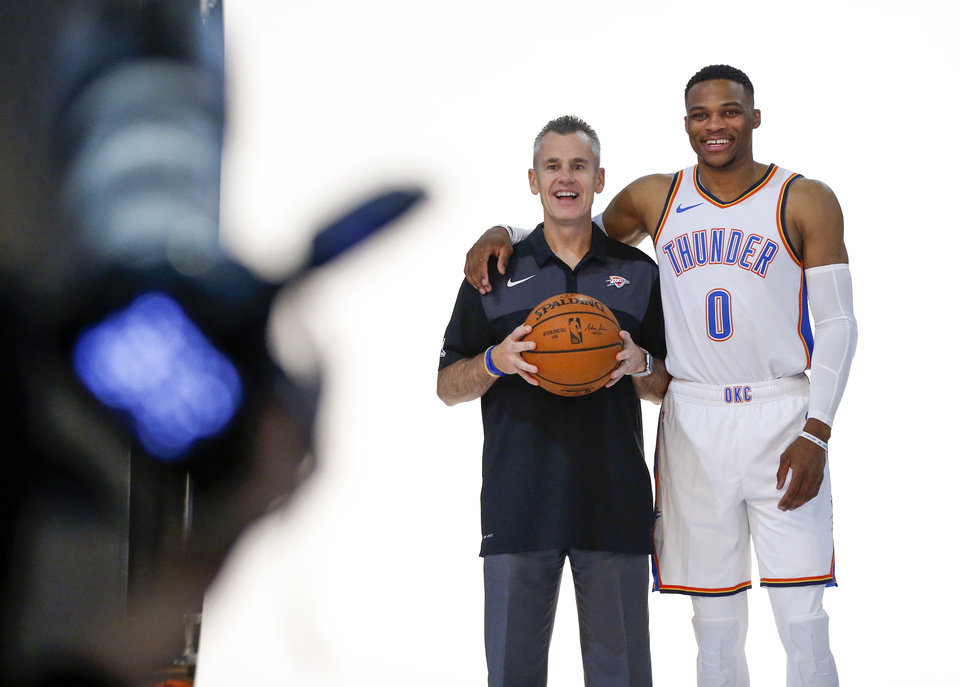Photo - Coach Billy Donovan and Russell Westbrook take a picture together during a photo shoot at media day for the Oklahoma City Thunder at Chesapeake Energy Arena in Oklahoma City, Monday, Sept. 24, 2018. Photo by Nate Billings, The Oklahoman