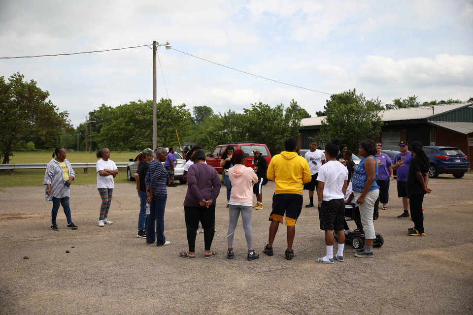 Photo -  A group of people gather at a Hugo, Oklahoma community center on April 29, 2019 in solidarity with a father whose children were injured during an officer-involved shooting on April 26, 2019. [HARRISON GRIMWOOD/Tulsa World]