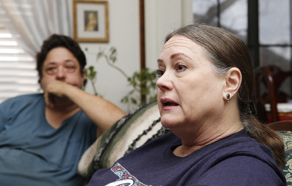 Photo - Mary Perryman speaks near her husband, Woody Perryman, at their home in Oklahoma City, Wednesday, March 4, 2020. Mary and Woody Perryman met at a support group for relatives of homicide victims. [Nate Billings/The Oklahoman]