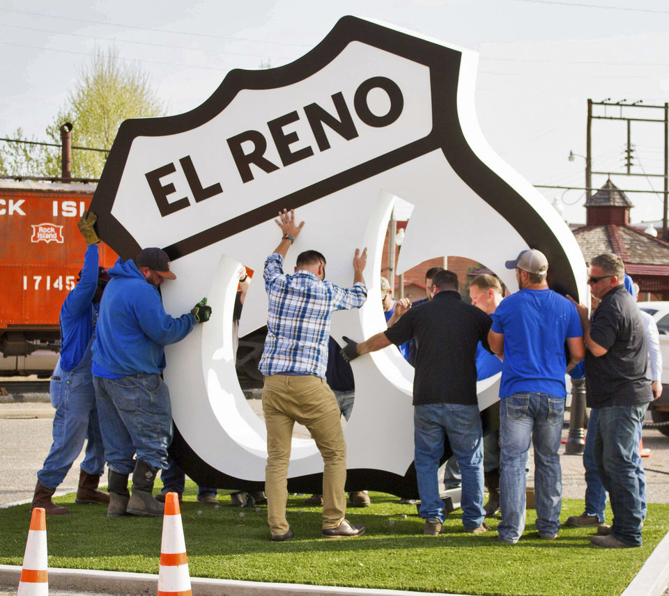 Photo -  Workers install a giant Route 66 sign in El Reno. The sign is intended to make tourists stop and take pictures with the iconic sign. [PHOTO PROVIDED]