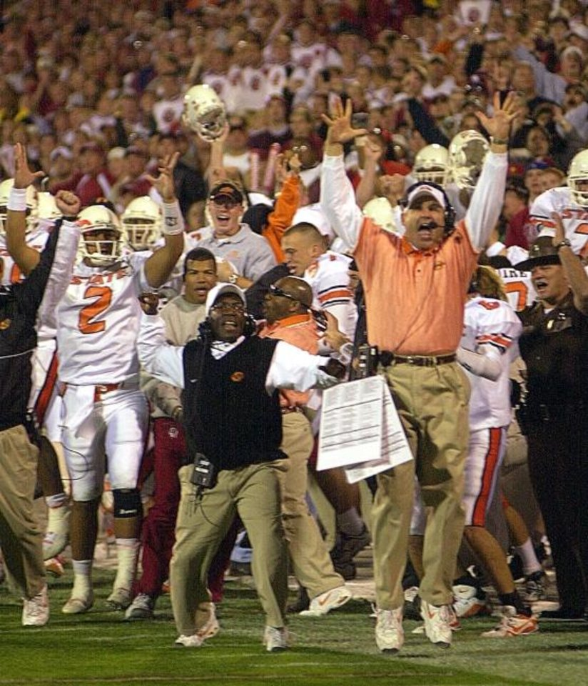 Photo -  With Les Miles jumping the highest, the OSU sideline erupts after the go-ahead touchdown in the waning minutes of the 2001 Bedlam football game. [Nate Billings/The Oklahoman]
