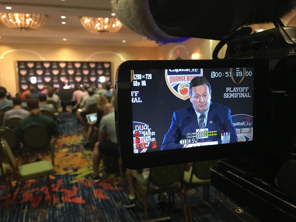 Photo - Image by Tim Money as he shoots Bob Stoops' press conference Wednesday morning in Florida.