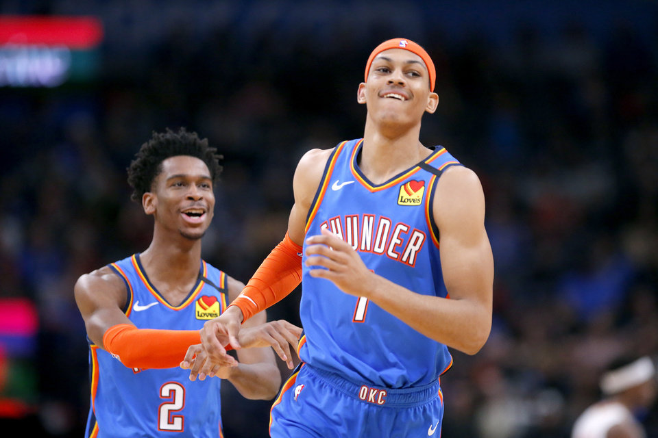 Photo - Oklahoma City's Shai Gilgeous-Alexander (2) and Darius Bazley (7) react after a play during the NBA basketball game between the Oklahoma City Thunder and the Atlanta Hawks at the Chesapeake Energy Arena in Oklahoma City,Friday, Jan. 24, 2020.  [Sarah Phipps/The Oklahoman]